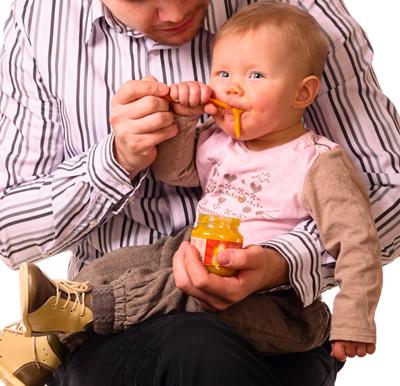 Photo of Father Feeding Son